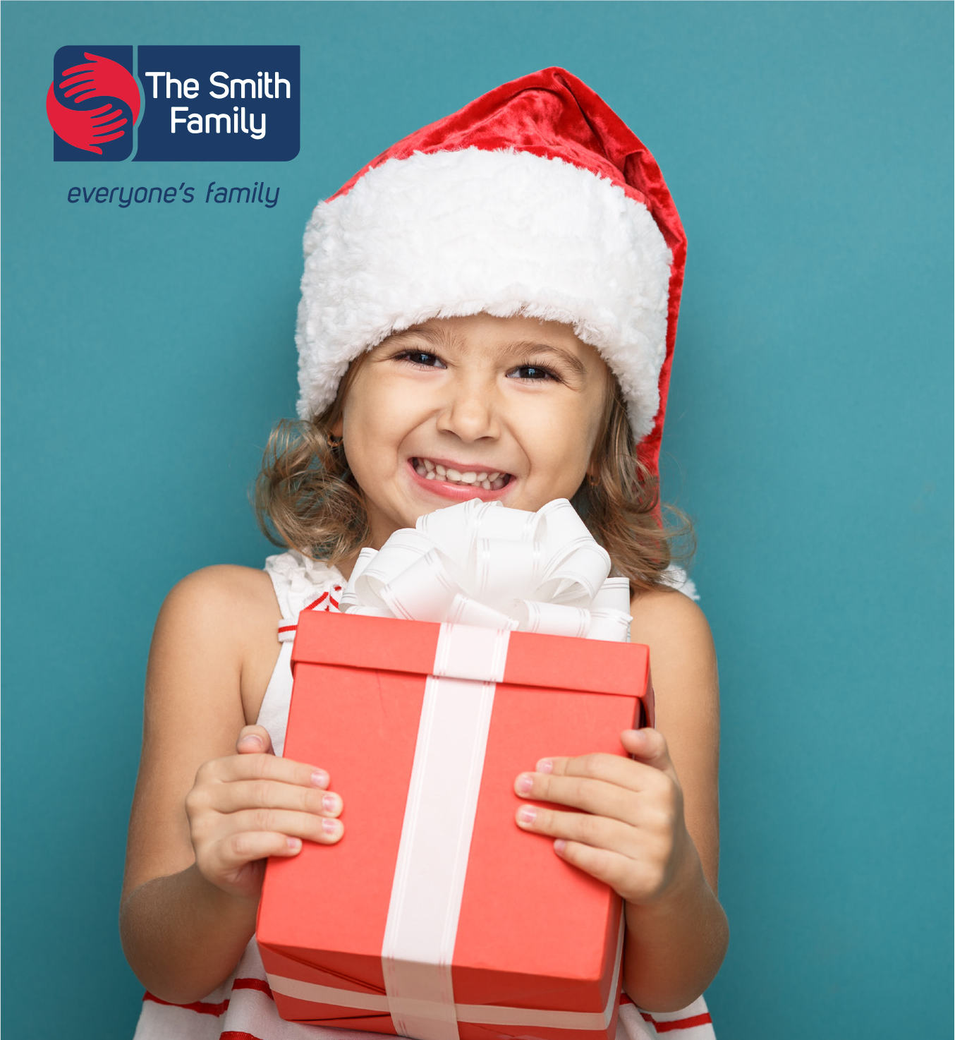 Young girl in santa hat holding gift