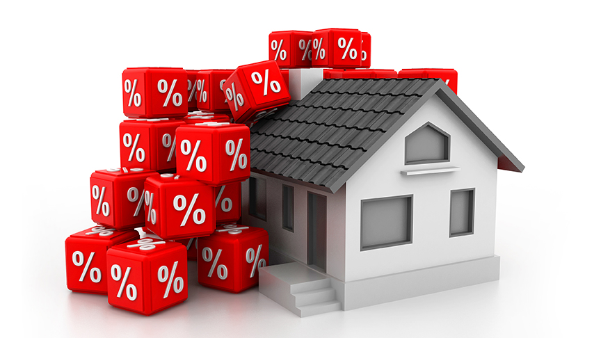 Red dice with percentage symbol and model house